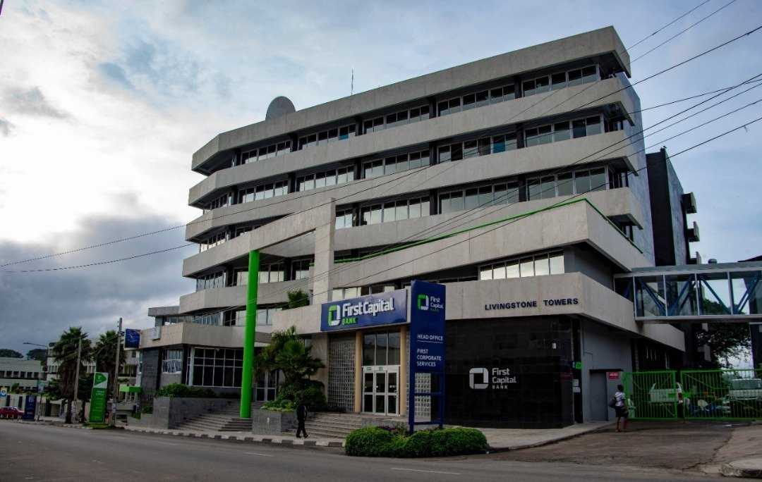 FIRST CAPITAL BANK CONFRONTS D...